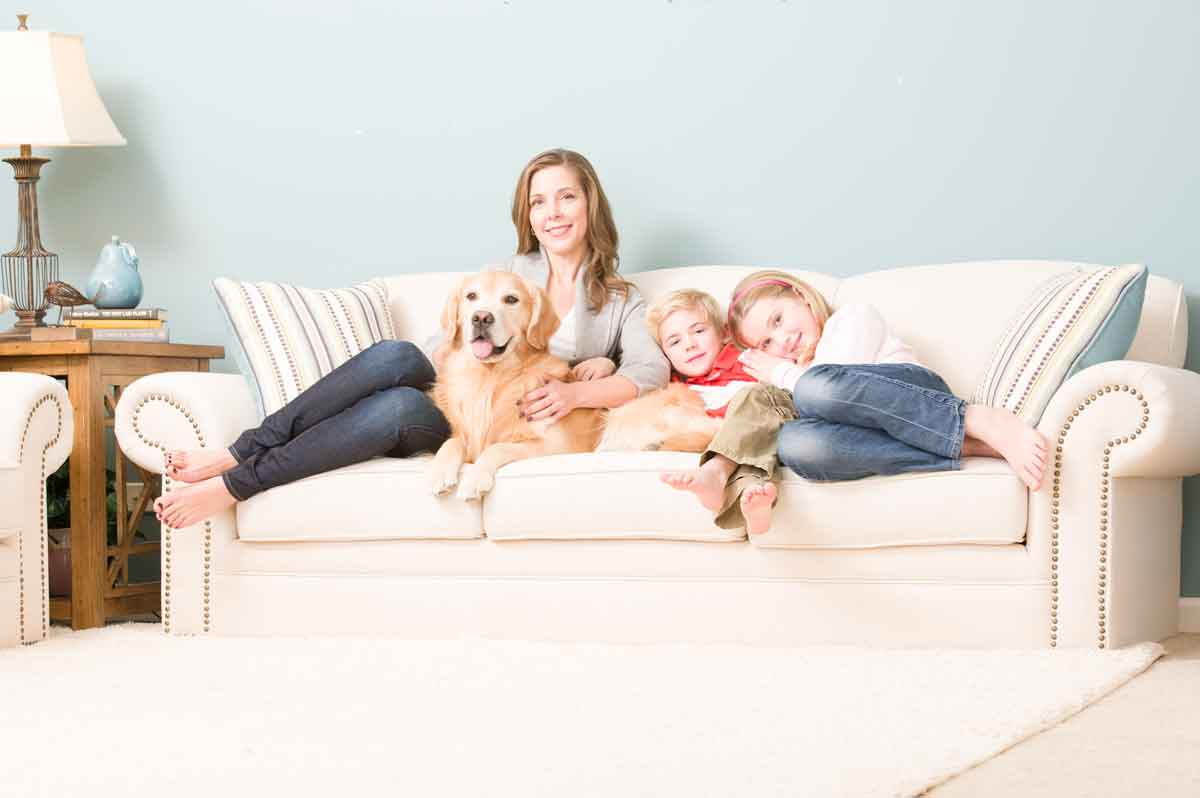 Family sitting on clean upholstery in Fort Smith, AR