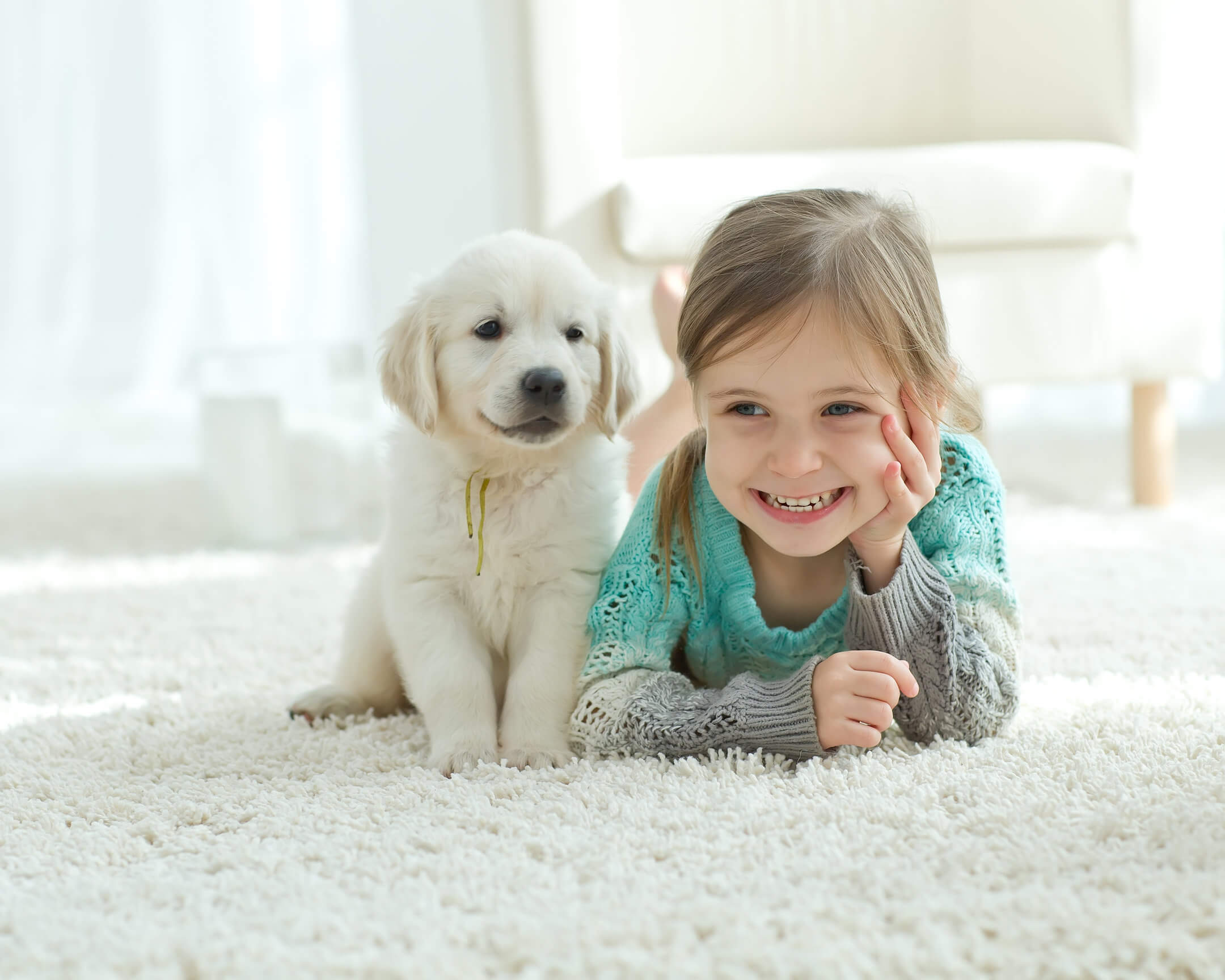 girl and puppy laying on carpet in fort smith
