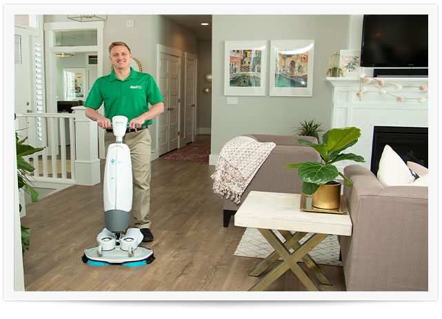 chem-dry tech performing wood floor cleaning in fort smith